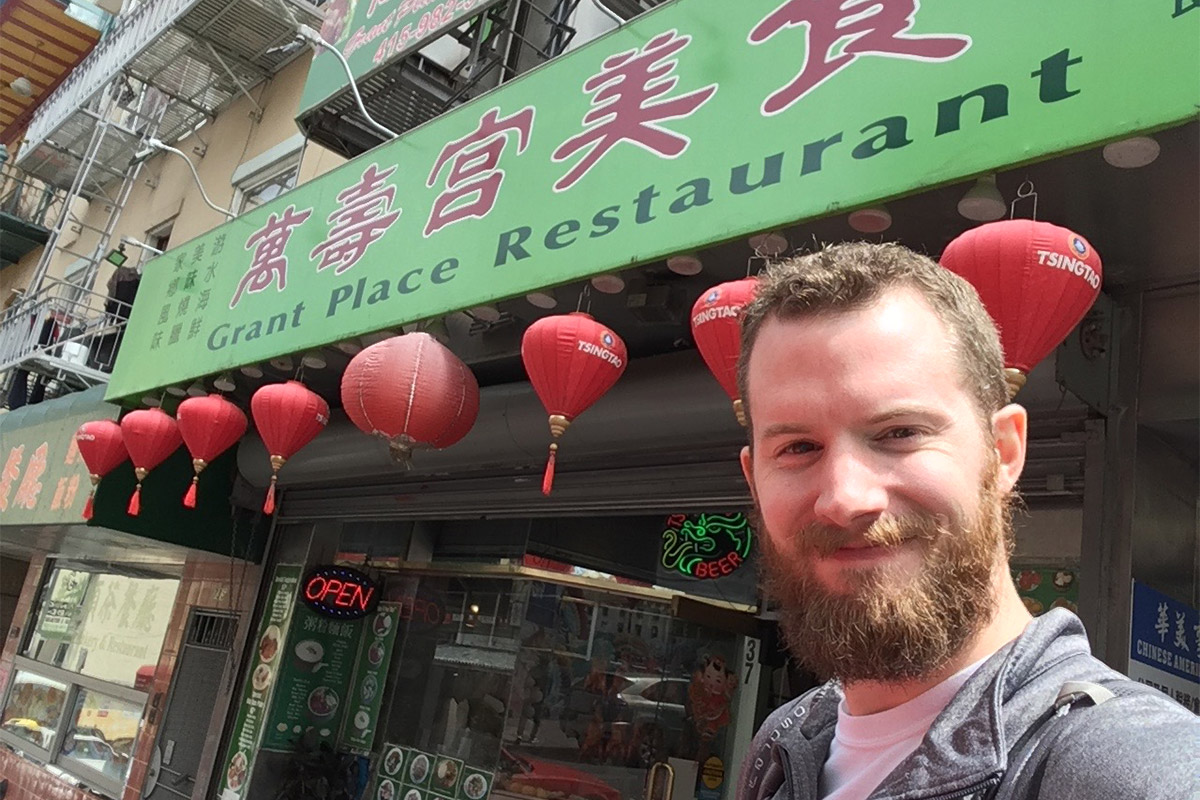 Ron Stauffer standing in front of Grant Place Restaurant in Chinatown, San Francisco