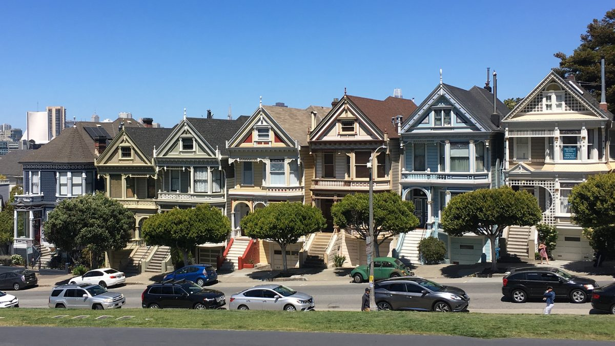 "A row of old fashioned homes called ""The Painted Ladies"" on Steiner Street across from Alamo Park in San Francisco"