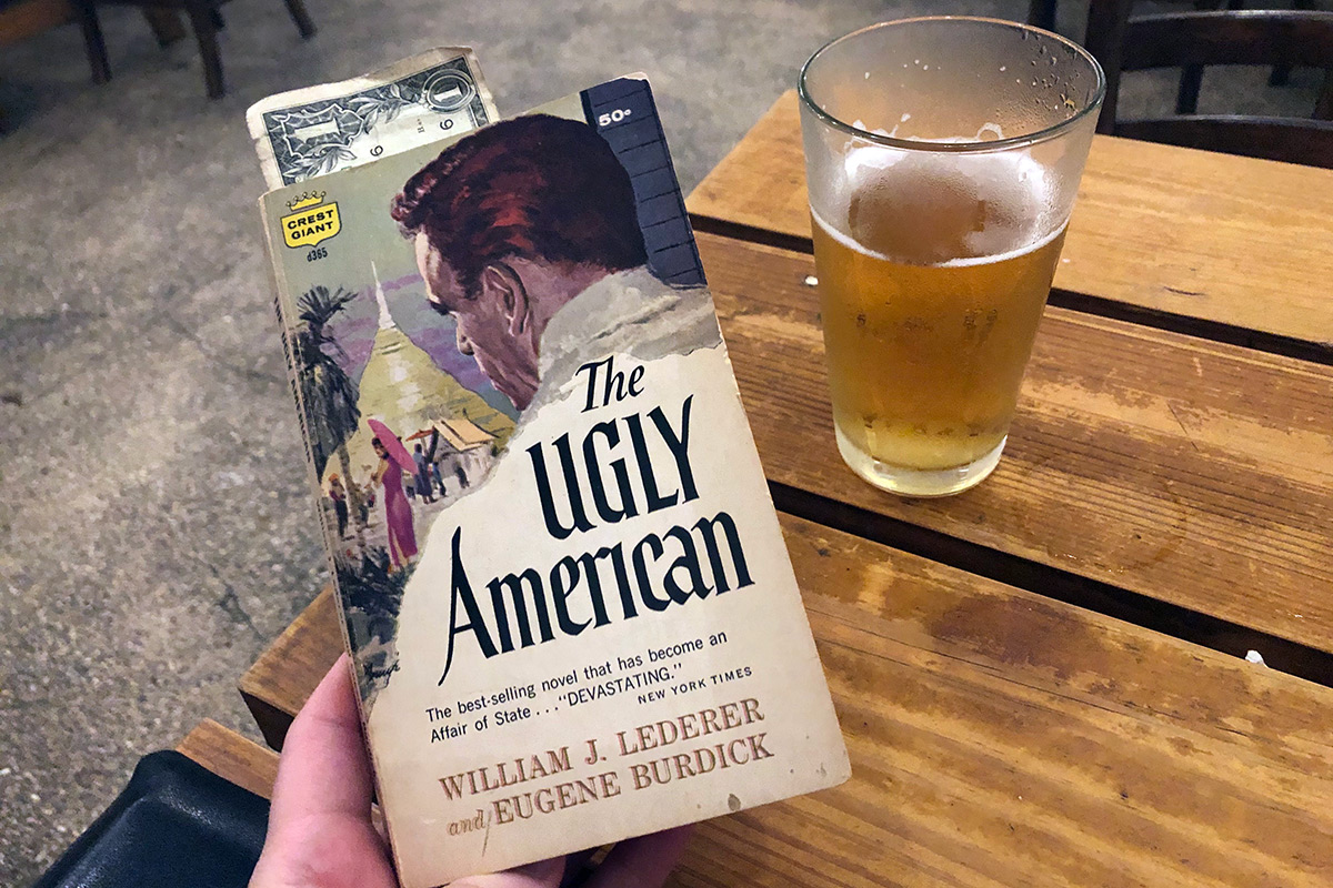 "Front cover of the book ""The Ugly American"" by William Lederer and Eugene Burdick"